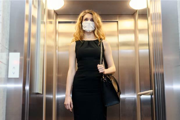 uv-health-group-home-woman-elevator-mask